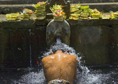Indonesia, Bali, Balinese man bathing with holy spring water