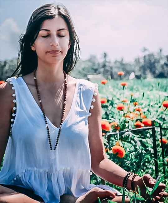 yogini-in-meditation-during-yoga-course-in-bali